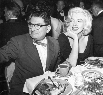 Sidney Skolsky and Marilyn Monroe attend an industry function.