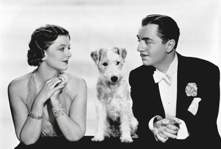 "Photo credit: Warner Bros. Entertainment/ Myrna Loy as Nora Charles, Asta the dog and William Powell as Nick Charles in ""After the Thin Man"" (1936)"