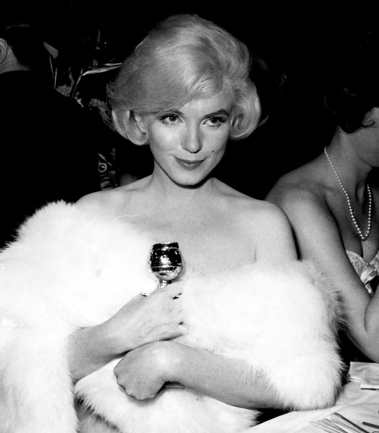 "Marilyn Monroe with the Golden Globe she won for 1959's ""Some Like It Hot."""