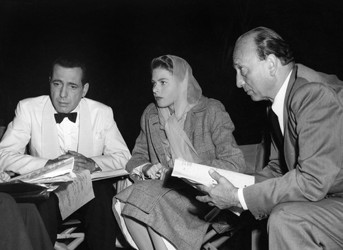 "Humphrey Bogart, Ingrid Bergman and Michael Curtiz on the set of ""Casablanca,"" which snared the gold in 1944. The film was released in late 1942 and competed with titles from 1943."