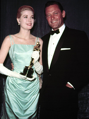 "Grace Kelly won the Best Actress gold for 1954's ""Country Girl."" I know, I know, it's not a noir but Kelly was one of Hitchcock's favorite blondes, she's shown with co-star William Holden (mmm) and I love the dress. Kelly quit acting in 1955 to marry Prince Rainier."