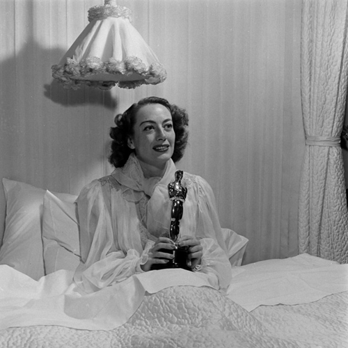 "Joan Crawford triumphed playing the title role in 1945's ""Mildred Pierce."" Director Michael Kurtiz accepted the award at the ceremony because Crawford was ill and confined to bed. Clearly, she perked up when she found out she won."