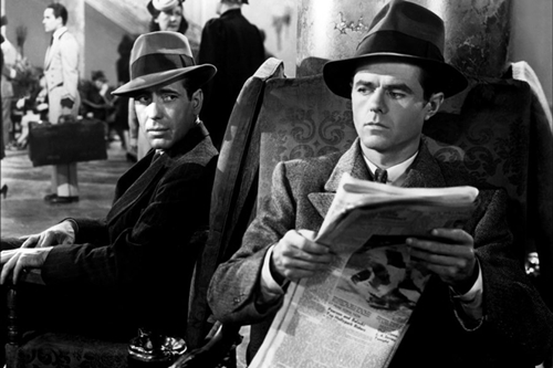 Tough-guy Sam Spade (Bogart) and wimpy Wilmer Cook (Elisha Cook Jr.) are perfect foils.