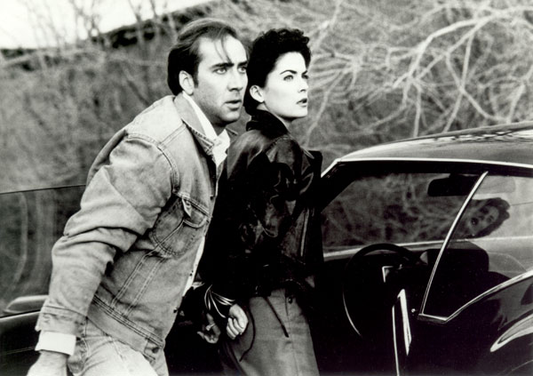 Nic Cage and Lara Flynn Boyle remind us of Robert Mitchum and Jane Greer.