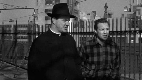 Karl Malden, as the crusading priest, talks with Brando's ex-pug, Terry Malloy.