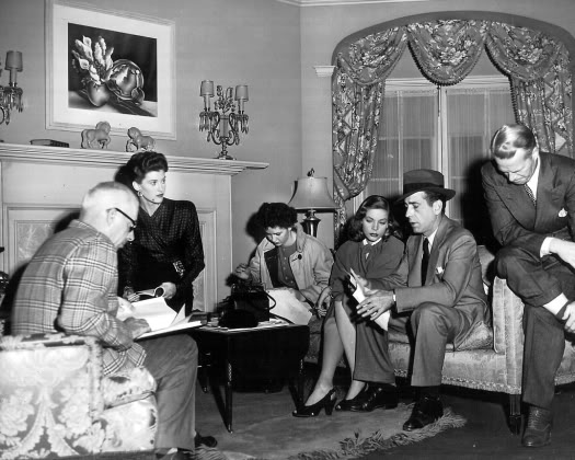 """The Big Sleep"" script is notoriously confusing. Here, director Howard Hawks, far left, and his team try to figure it out. The film's own backstory is also a bit tangled."