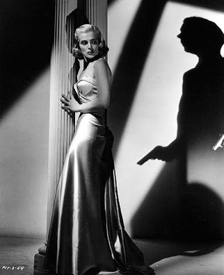 "Lizabeth Scott and Dick Powell star in ""Pitfall."""