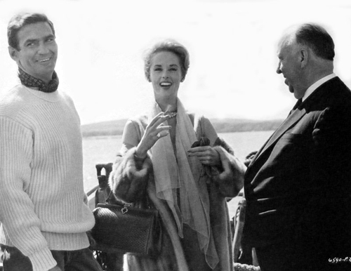 "Rod Taylor, Tippi Hedren and Alfred Hitchcock on location for ""The Birds."""