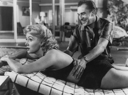 "Vincent Price and Rhonda Fleming are up to no good in ""While the City Sleeps"" from 1956."