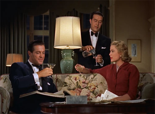 "Robert Cummings, Ray Milland and Grace Kelly form the love triangle in ""Dial  M for Murder."""