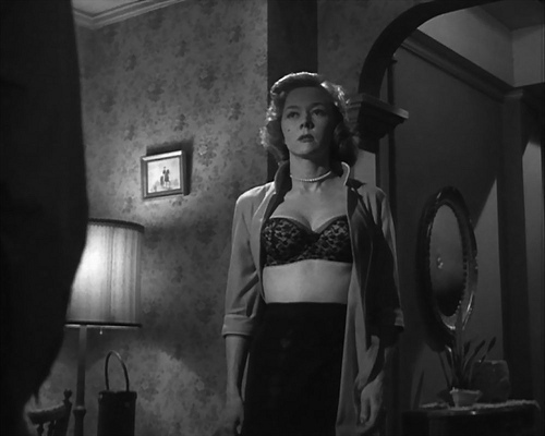 "Gloria Grahame plays Robert Ryan's sultry neighbor in ""Odds Against Tomorrow."""
