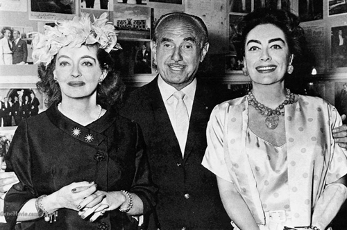 Bette Davis, Jack Warner and Joan Crawford in 1962.