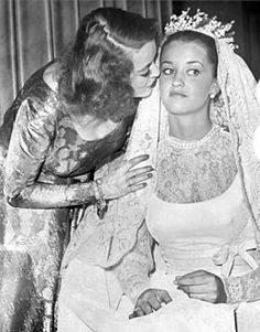 Bette Davis kisses her daughter B.D., who married at age 16.