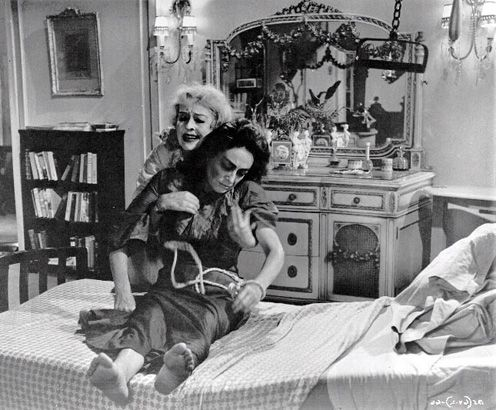 Joan Crawford reportedly put weights in her pockets for this scene with Bette Davis.