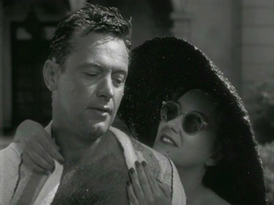 Joe (William Holden) lets Norma (Gloria Swanson) dry him after a swim.