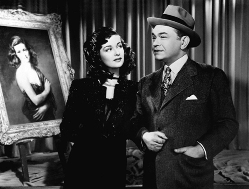 "Alice (Joan Bennett) has Professor Richard Wanley (Edward G. Robinson) wrapped around her little finger in ""The Woman in the Window."""