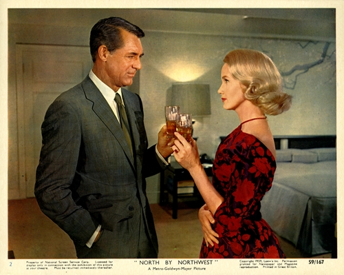 Cary Grant and Eva Marie Saint share a swanky cocktail.