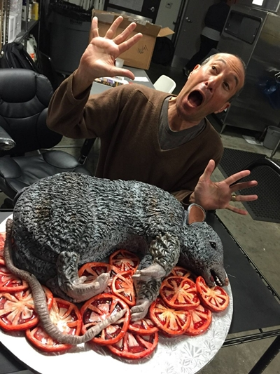 "Eek! Greg Laemmle reacts to the cake, a superb creation by Shakar Bakery. The cake references an unforgettably gross moment in ""Baby Jane."""