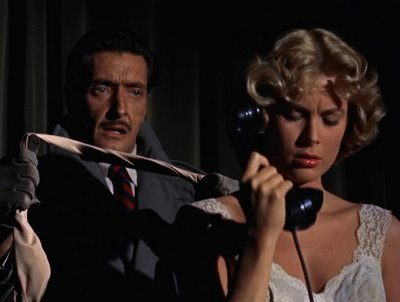 "Anthony Dawson tries to do away with Grace Kelly in ""Dial M for Murder."""