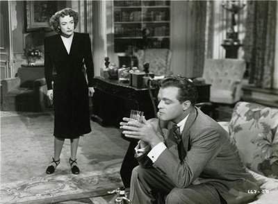 "JC plays the consummate crazy lady in ""Possessed,"" which co-stars the great Van Heflin."